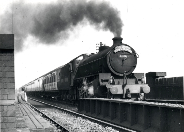 British Railways (ex-LNER) B1 class 4-6-0, No. 61106, pictured hauling 'THE SOUTH YORKSHIREMAN' on the approach to Leicester Central Station, circa 1955. Note the man casually sitting on one of the bridge girders, and the wording