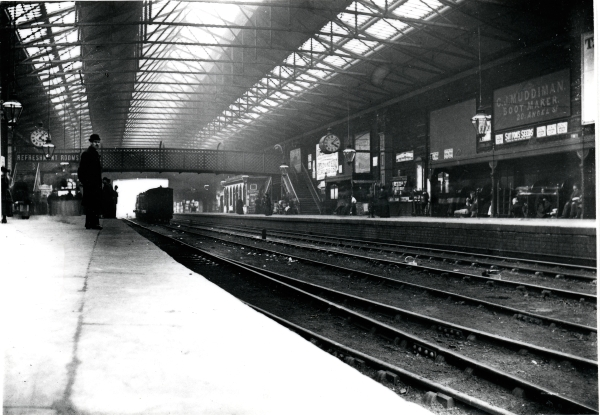 Interior view of Sheffield Victoria station looking along one of the covered platforms, sometime around 1894. Of interest are the two large station clocks and the various advertisements (i.e. Suttons Seeds, Muddiman Boot Makers). Sadly, the station was to lose the impressive overall roof in later years.