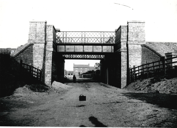 Bridge No. 399, built to carry the railway over what would be Station Street in Whetstone, Leicestershire. The station would eventually be built to the right of the bridge, with access being gained through a doorway and staircase in the right (southern) abutment.