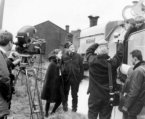 In 1968, the BBC produced an adaptation of E. Nesbit's book 'The Railway Children' as a television series. SIR BERKELEY had a starring role in the series, and is seen here with Jenny Agutter, Gillian Bailey, Neil McDermott and Gordon Gostelow during filming at Oakworth Station on the Keighley & Worth Valley Railway.