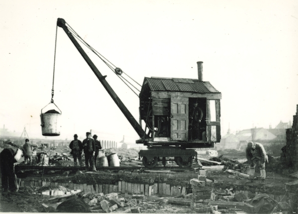 A steam crane at work. The crane's cab is not an original feature, but an improvised shelter of wood and corrugated metal.