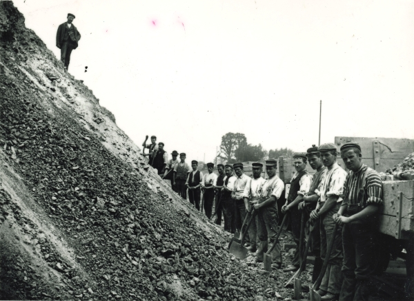 Navvies working on a tip slope near Swithland, Leicestershire. The photograph is a fine illustration of the large numbers of men required for the Railway's construction, despite the contractor's use of steam powered machinery wherever possible. Note the tipping wagons on the right of the picture: it was said that a good navvy could fill eight of these in a single day.