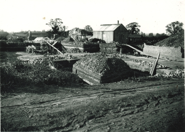 Contractor's yard at the site of Quorn & Woodhouse station, circa 1897. The square structure at the centre of the photograph is the foot of a bridge pier.