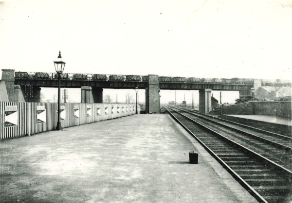 Girder bridge taking the Great Central's London Extension over the Midland Railway station at Loughborough on 21st August 1899. The brick wall seen on the left is the boundary wall for the Falcon Street/Railway Terrace junction.