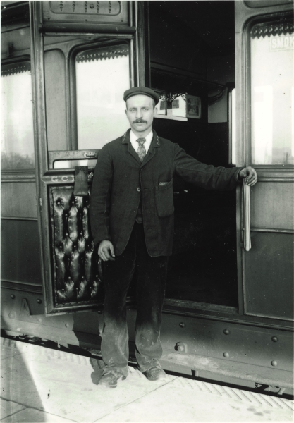 Carriage washer standing by a passenger carriage at Leicester Central, circa 1900. From the photograph, it is easy to see why Great Central carriages had a reputation for being well-furnished and comfortable. Note the 'GCR' badges on the man's lapels.