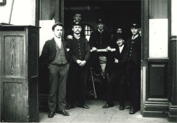 Seven railwaymen at the Great Central Station, Leicester, circa 1900. These porters and clerks were probably amongst the first staff to work at the Station, the Railway having opened just a year or two before.