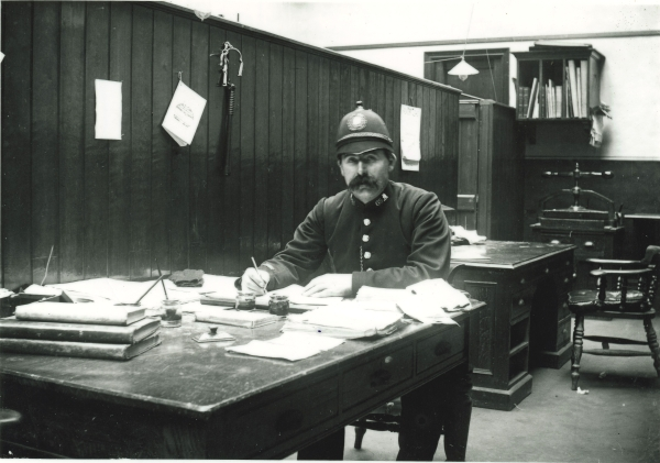 Leicester Central's very own police officer, P.C. Milburn, working at Leicester Central Station, circa 1900. Note the truncheon, whistle and cuffs hanging on the wooden partition.