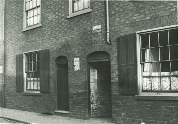 The Sunlight Cottages on Friars Causeway, Leicester, as seen in 1895. These houses were situated in the part of Friars Causeway that would eventually be buried beneath the new station. The name-stone above the central archway indicates that the properties were somehow connected to the Sunlight Soap company.