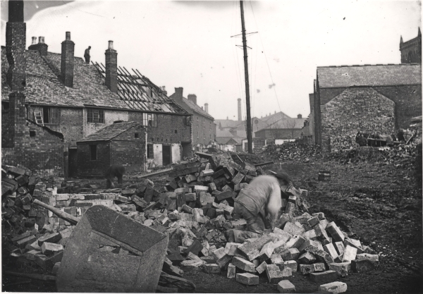 Demolition work on Leicester's Talbot Lane in readiness for the coming of the railway, circa 1895. The small size of the dwellings is quite apparent, as is their proximity to the factories beyond.