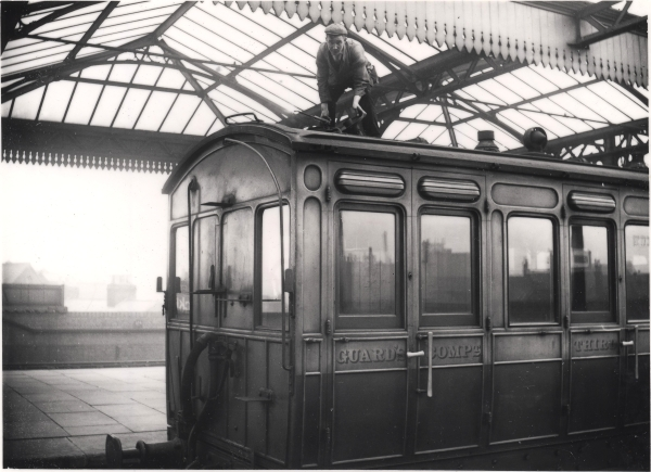 Lampman working over the Guard's Compartment of a carriage at Leicester Central station, circa 1900. Unlike many of the Great Central employees photographed by Newton, this railwayman's identity is sadly unknown.