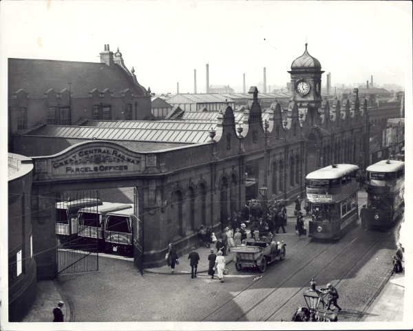 Leicester Central as seen from Great Central Street, circa 1925. The prominent and ornate gables are visible above the main station entrance along with the attractive clock tower. Interestingly, the people appear to be crowding through the taxi entrance, rather than using the main entrance beneath the clock tower.