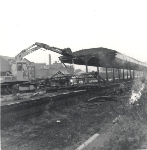 This depressing photograph shows a Hy-Mac excavator getting its teeth into an iron frame platform canopy at Leicester Central Station in December 1970. Like many of the former railway sites, the land had been sold for development after the line's closure the year before and is now home to an industrial park. Fortunately, the station frontage and main booking hall still survives.