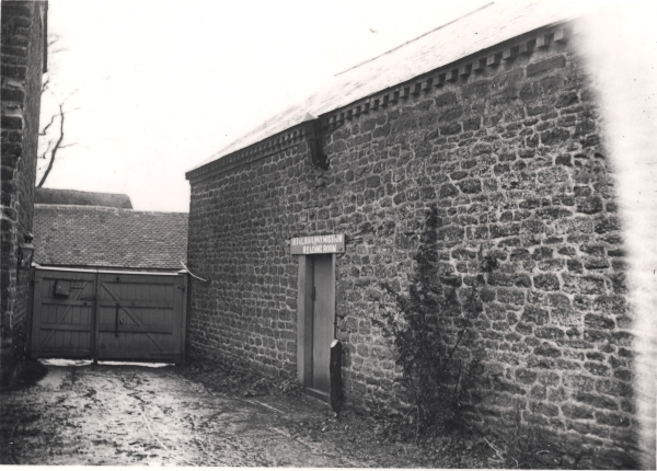 This is an exterior view of the modest outbuilding that was used for the Mission Reading Room at Staverton, Northamptonshire. With local committees of the Society mostly having to pay for the halls within their area, buildings such as this provided a practical and inexpensive space in which to house the navvy missions.