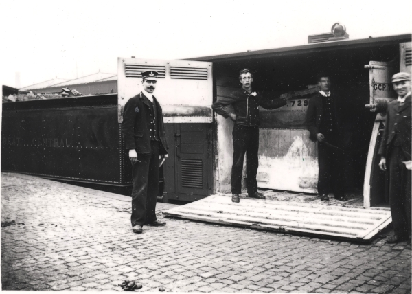 The Goods Guard, Mr H. G. Banyard, seen here on the left, poses with three railwaymen at Leicester Horse Dock, circa 1900. As the tender on the left of the picture is brimming with coal, these men are presumably loading the wagon prior to departure.