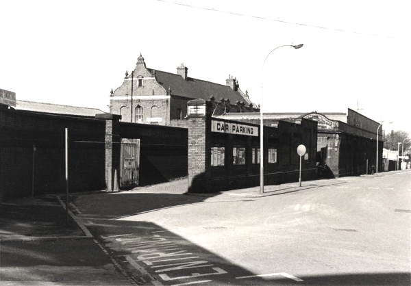 This was how Leicester Central station looked in February 1977, eight years after the closure of the railway. Much of the site is in use as a car park and small businesses have taken over the surviving buildings. Note the British Railways totems above the main entrance.