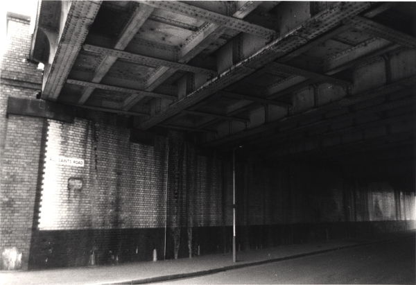 All Saint's Road bridge as seen in March 1977. The great width of the viaduct at this point is clearly apparent, as are the glazed bricks on the abutments. However, looking at the condition of the bricks, it is doubtful that they created any extra light by this date.