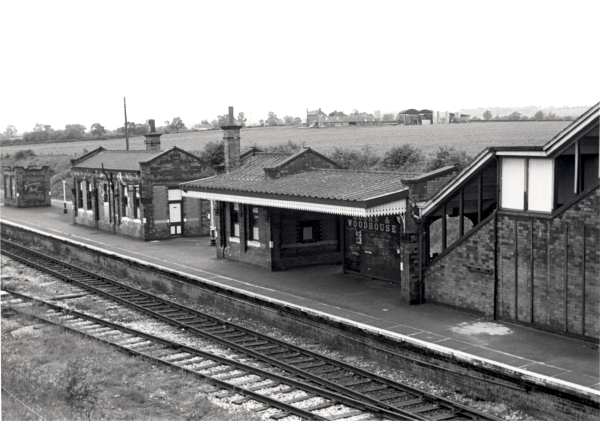 Looking down on Quorn & Woodhouse station, this is a view that could be seen at the majority of stations on the Last Main Line. The covered staircase on the right of the picture led down from the bridge, and brought people onto the single 'island' platform.