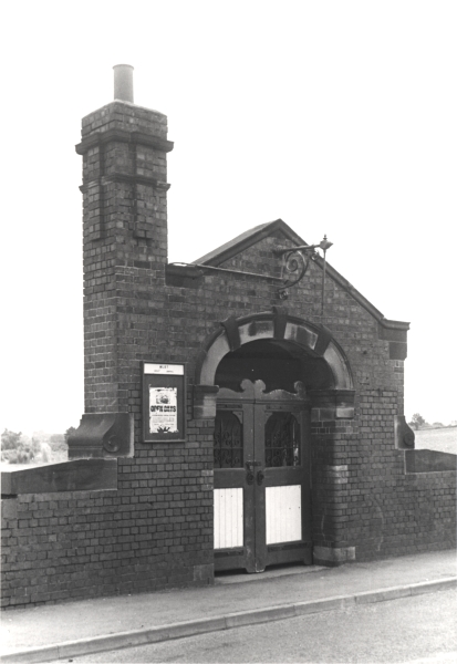 The entrance to the Great Central station at Quorn & Woodhouse. After passing through these gates, passengers would descend a covered staircase before emerging on to the station's single 'island' platform.