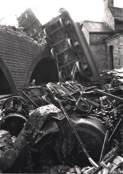 A memorable image from the Newton Collection of a Robinson Class O4, 2-8-0 locomotive, seen here after something of a catastrophe on the Leicester viaduct at Northgates. The loco, driven by Bertram Duckworth, had been at the head of a goods train when it collided with a light engine in the fog, forcing the 2-8-0 through the viaduct's brick parapet and into the back garden of a local anglers, Wadsworth & Son. Both Mr Duckworth and his fireman, John Stocks, escaped serious injury, as did the driver and fireman of the light engine, Percy Banyard and Dennis Moore.'