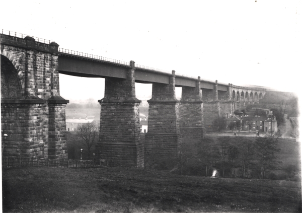 Dinting Vale viaduct - as seen on 18th May, 1903. The appearance of this majestic stone and iron structure would later be marred by the construction of supporting pillars under each of the main girder spans.