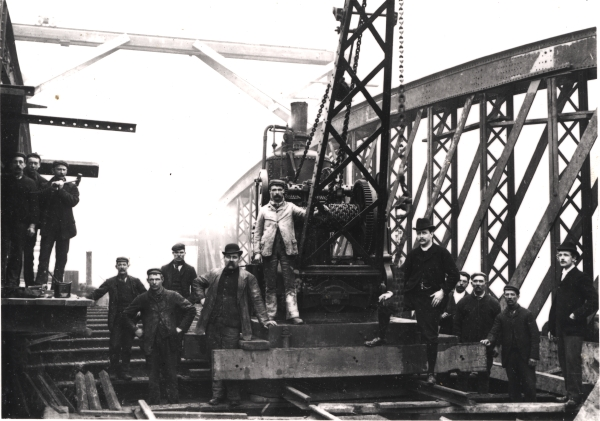 A gang of navvies pose with a missionary (standing fifth right) during construction of the bowstring girder underbridge that carried the London Extension across Braunstone Gate, Leicester. Most of the missionaries were drawn from the working classes, and despite their much valued role within the Navvy Mission Society, these lay preachers were actively discouraged from seeking ordination.