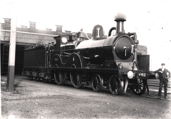 Photographed outside the shed at Woodford, this handsome engine is the 4-4-0 Class 11A main line locomotive No. 852, designed by Harry Pollitt in 1897 and later modified by John Robinson.