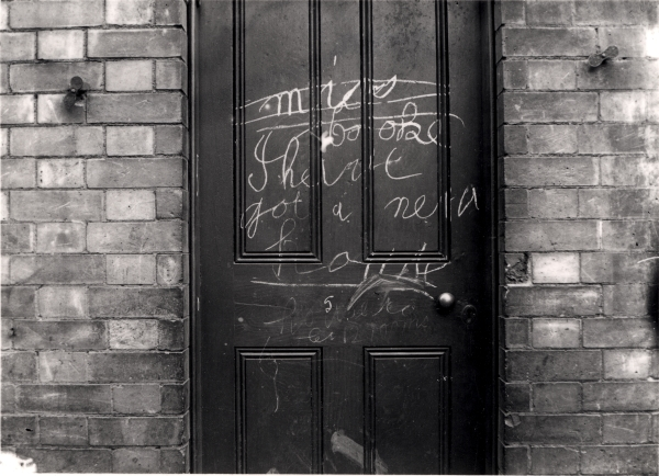 Photographed around 1896, this graffiti was chalked on the door of one of the many houses on Charlotte Street that were demolished to make way for Leicester Central station. Interestingly, the message appears to read, 'Miss Cooke. I have got a new house'. An astute comment given that displaced residents were indeed rehoused at the Railway's expense.