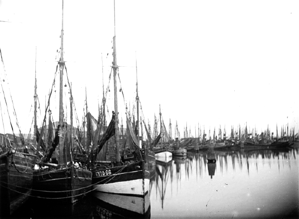 S. W. A. Newton was a prolific photographer who made repeated expeditions across the country in pursuit of many interesting subjects. This excellent picture was captured at Grimsby, on the eastern edge of the Great Central network and shows many of the community's fishing vessels moored in the harbour.