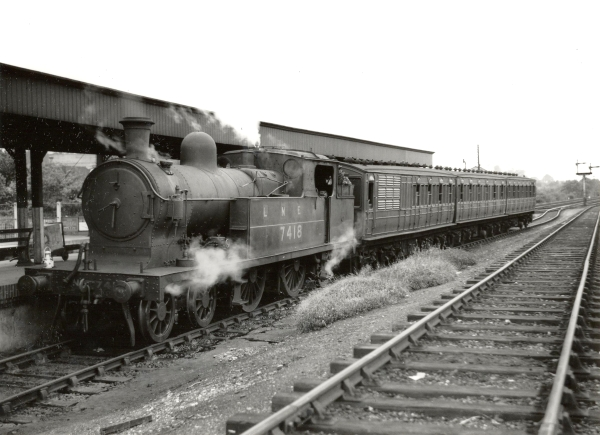 A change of ownership meant a change of livery for the old Great Central locomotives. This photograph shows former Great Central class 9L, now reclassified C14 and numbered 7418, in its new livery of black at Chalfont & Latimer station on the Metropolitan line during July 1948.