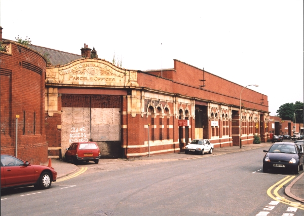 The main facade of Leicester Central station, as seen on 19th July, 2002. Much of the structure is still intact, although the ornate false gables and clock tower have long since been removed. On the wall above the entrance (which replaced the gables) are two steel poles which once held British Railways totem signs.