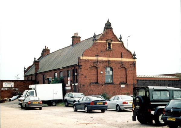 Still standing proud are the former Parcels Offices at Leicester Central Station. Since the station's closure in 1969, the buildings and offices have been used as industrial premises. The station platforms would have been to the left of the photograph, while the main entrance was to the right. Note the sandstone and terracotta finials and ornamentation on the building's gable ends.