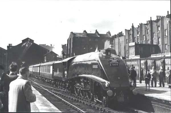 On 12th May 1956, Ian Allen Publishing ran a special train over the London Extension to Doncaster. The locomotive used was A4 class 4-6-2, No. 60014 - SILVER LINK which had been brought in for the occasion from its usual base at Kings Cross. The immaculate locomotive, sister to the record-breaking MALLARD, stands at Marylebone awaiting departure with a rake of Pullman stock.