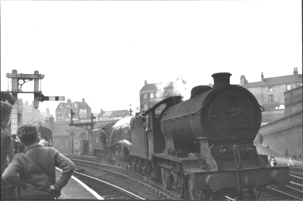 24th April 1957, A4 4-6-2, No. 60029, WOODCOCK, failed to complete it's run and had to be removed from the train at Nottingham Victoria. Here we can see the stricken locomotive being shunted out of the way by the station pilot - Gresley designed J39 0-6-0, No. 64715.