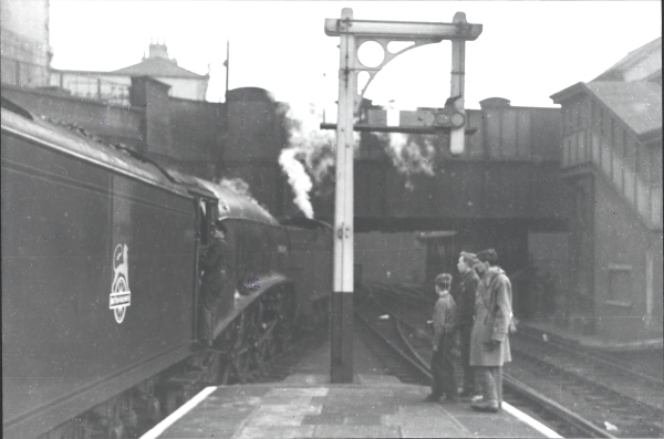 Trainspotting at Nottingham Victoria Station. Here we see the A4 4-6-2, No. 60029, WOODCOCK, having failed and being removed by the station pilot.