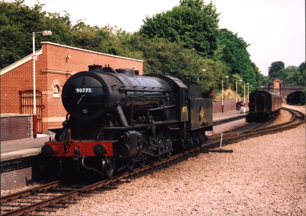 The new Great Central Railway (operated by the Main Line Steam Trust) is one of the country's leading preserved lines, and as such is host to many large locomotives. One such visitor was this former War Department 'Austerity' 2-10-0 locomotive. The locomotive, carrying the fictitious British Railways number of 90775, runs around its train at Leicester North on 19th July 2002.