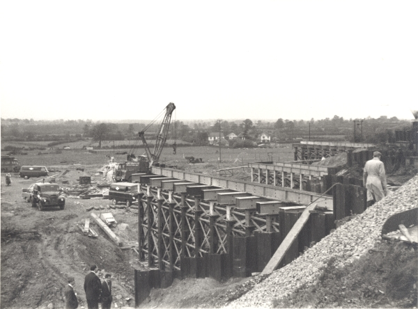 The M1 motorway was built in the early 1960's and it severed the Great Central Railway's London Extension at a point midway between Whetstone and Cosby. A new girder bridge was built with little disruption to the railway services.