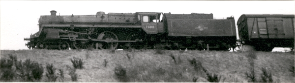 The Standard 5MT was R. A. Riddles' development of William Stanier's 'Black 5' 4-6-0's, and proved to be a popular design. This example is working a parcels train through Whetstone, circa 1963.