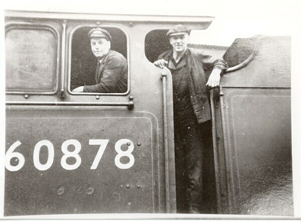 Engine driver, Tom Chamberlain, and his fireman (name unknown) standing on the footplate of a V2 engine. Tom worked extensively on the GCR and LNER, progressing from cleaner to being a regular driver of the Flying Scotsman, quite a career.